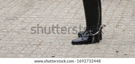 Boots and spurs of Royal Horse Guards soldier in London. Copy space on left.