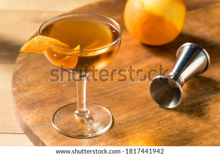 Boozy Classic Hanky Panky Cocktail with Gin and an Orange Garnish Stock photo ©