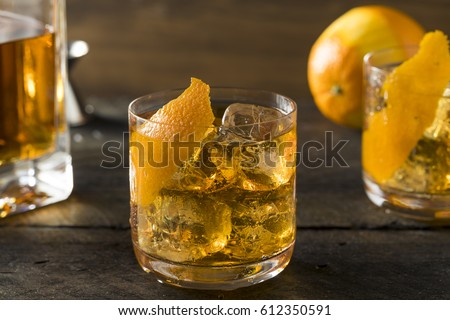 Boozy Homemade Old Fashioned Bourbon on the Rocks with an Orange Garnish