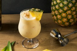 Boozy PIneapple Painkiller Cocktail with Coconut Cream and Nutmeg