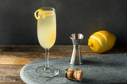 Boozy Refreshing French 75 Cocktail with Lemon and Champagne