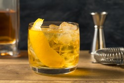 Boozy Refreshing Rusty Nail Cocktail with Lemon Garnish