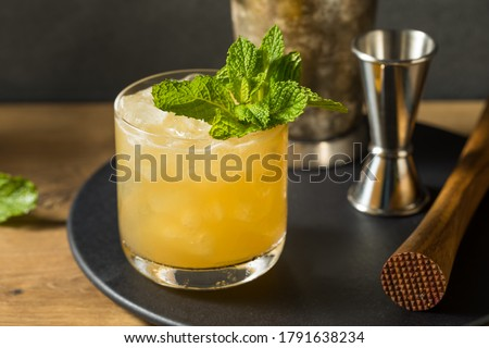 Photo of  Boozy Refreshing Whiskey Smash with Lemon and Mint