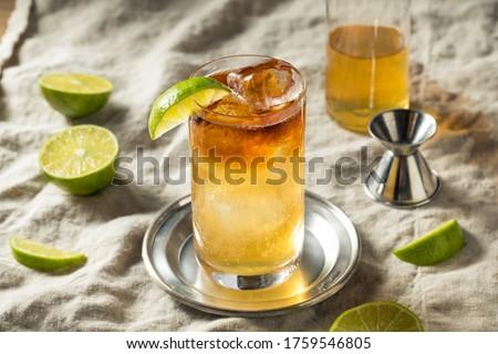 Boozy Rum Dark and Stormy Cocktail with LIme Stok fotoğraf ©