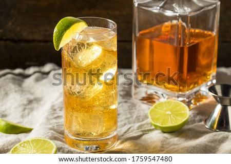 Boozy Whiskey Ginger Ale Cocktail with LIme Stockfoto ©