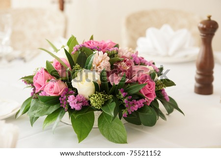 Boquet of orchid flowers and tulips on arranged table