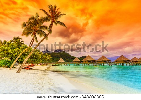 Bora Bora, French Polynesia. Otemanu mountain, beach and palm trees.