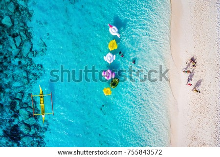 Photo of  Boracay island, Philippines, top view of people enjoying the beach on a sunny day.