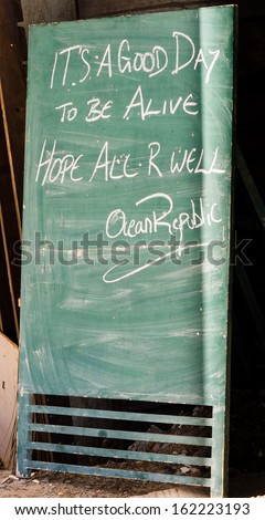 "BORACAY, PHILIPPINES - NOVEMBER 9 2013: A chalk board reads ""It's a good day to be alive"" outside a building in the Philippines following the passing of Super Typhoon Haiyan"