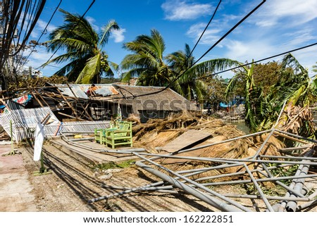 BORACAY, PHILIPPINES - NOVEMBER 9 2013:  A wooden building is reduced to nothing more than a pile of rubble by Super Typhoon Haiyan.