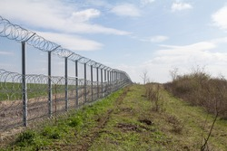 Border fence between Rastina (Serbia) & Bacsszentgyorgy (Hungary). This border wall was built in 2015 to stop the incoming refugees & migrants during the refugees crisis, on Balkans Route.