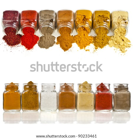 border frame of powder colorful spices in glass bottle isolated on white background