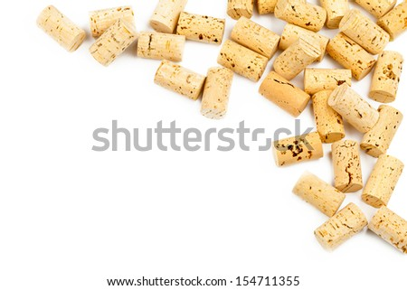 Border from wine corks on white background