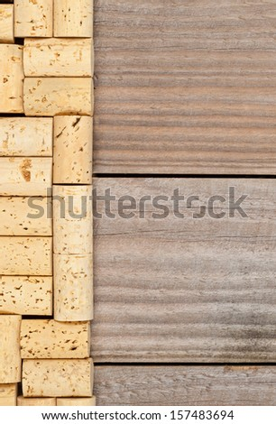 Border from wine corks on wooden planks background