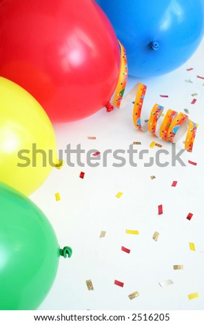 Border made from colorful balloons and confetti over white, focus on green ballon