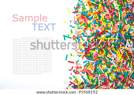 Border made of little colorful candy isolated on white background  with sample text