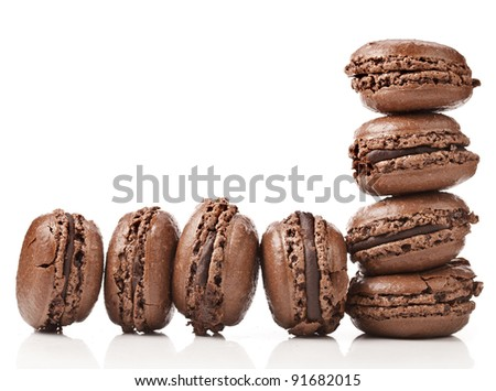 border of chocolate macaroons  isolation of a white background