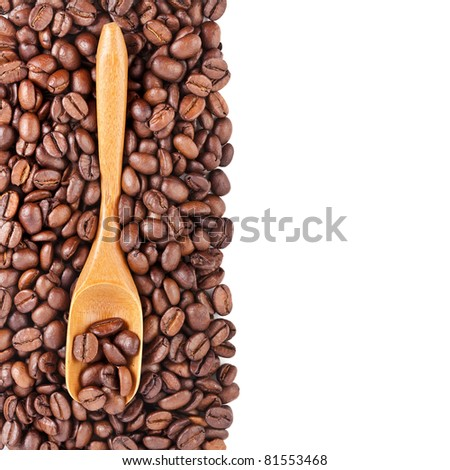 border of coffee beans with wooden spoon , isolated