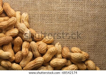 Border of peanuts on burlap