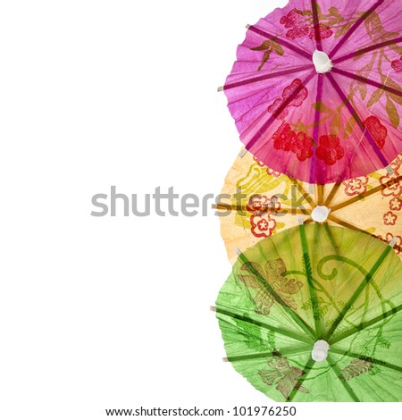 border of umbrellas for cocktails isolated on white background