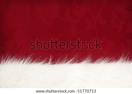 Border of white fur over festive red brocade.  Lots of copy-space.