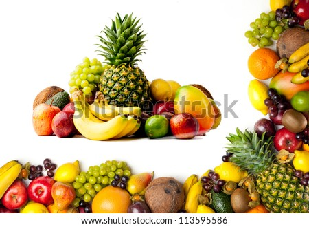 Border or frame of colorful fruits.  Assortment of exotic fruits, isolated on white background. #113595586