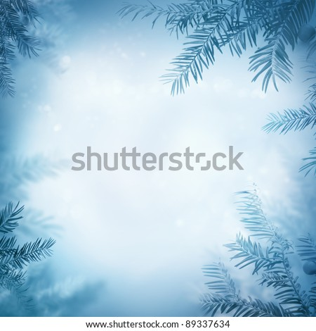 Border winter nature background. View through the pine branch with berries
