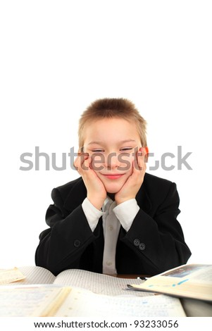 bored and tired schoolboy on the table - stock photo