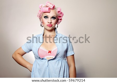 Bored attractive girl with curlers, similar available in my portfolio
