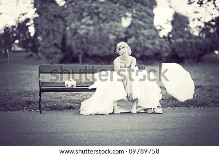 Bored bride in a park