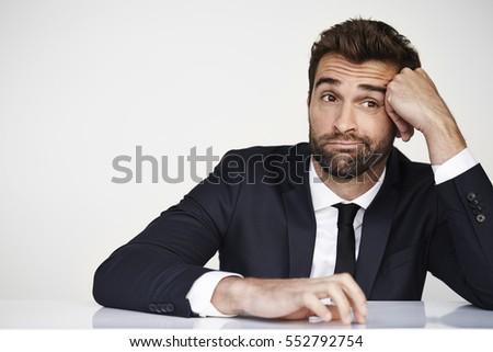 Bored businessman looking away in studio