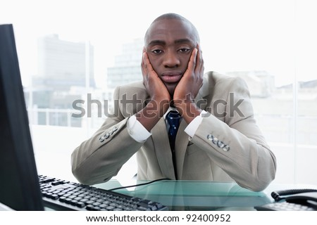 Bored businessman posing in his office