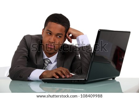 Bored businessman sat at his desk