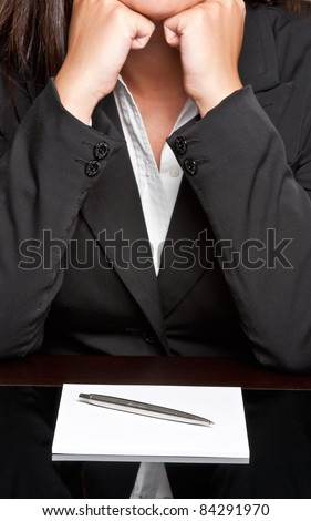 Bored businesswoman sitting at a table