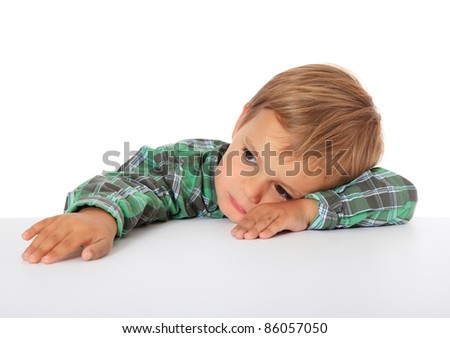 Bored caucasian boy. All on white background.