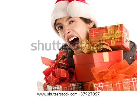 Bored christmas boy holding gifts yawning isolated on white background