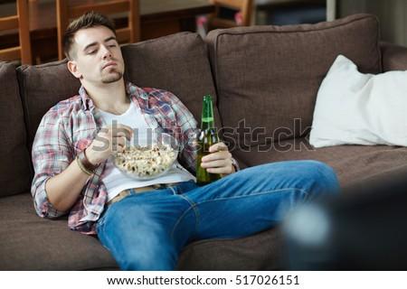 Bored couch potato #517026151