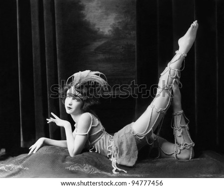 Bored dancer posing in beaded costume