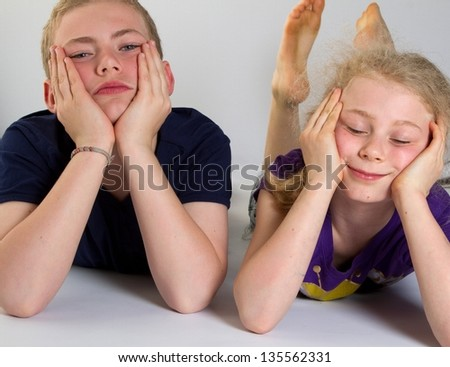 Bored kids with white background; shot in studio