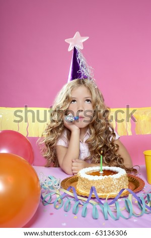 bored little blond girl in a birthday party with cake and candle on pink background