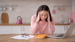 Bored sleepy asian lady sitting at desk with laptop, holding head, resting on hand, sleeping at workplace, tired young female feeling drowsy, lazy and unmotivated student, boring job, lack of sleep