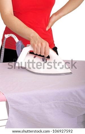 bored woman is ironing a striped shirt