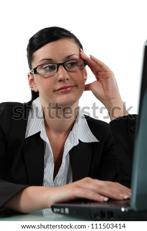 Bored woman sitting at her laptop