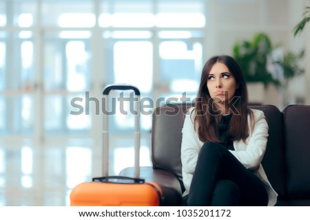 Bored Woman with Suitcase in Airport Waiting Room\ Upset girl traveling along waiting for the next flight