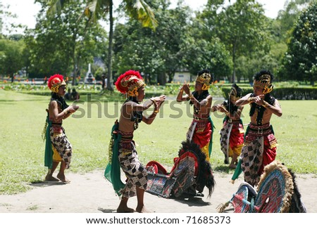 BOROBUDUR, INDONESIA - FEBRUARY 3: Unidentified boys in colorful costume performing Jathilan dance to summon spirit on February 3, 2011 in Borobudur, Indonesia. Jathilan dance is a ancient Java ritual