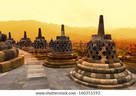 Borobudur Temple at sunset. Ancient stupas of Borobudur Temple. Yogyakarta, Central Java, Indonesia.