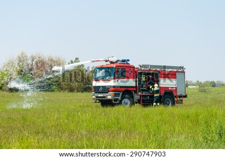 BORYSPIL, UKRAINE - MAY, 20, 2015: Fire-brigade on Fire Engine Mercedes using a water cannon during a training event at Boryspil International Airport, Kiev, Ukraine