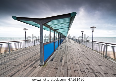 Boscombe Pier at Bournemouth in Dorset. Built in 1884 it has recently been renovated. A storm is brewing - stock photo