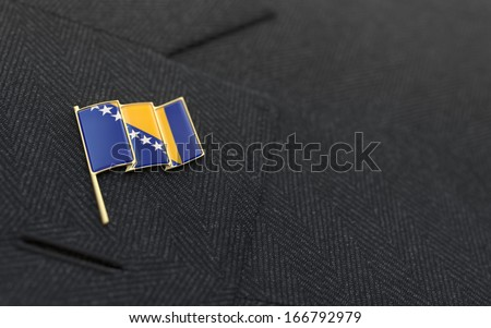 Bosnia and Herzegovina flag lapel pin on the collar of a business suit jacket shows patriotism