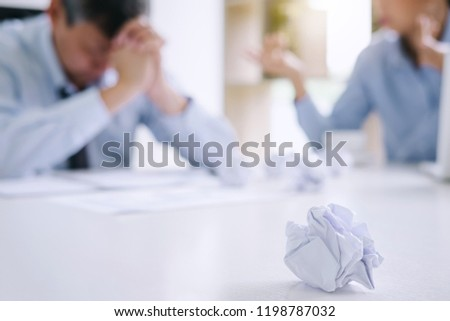 Boss and executive team feeling stress and serious of fail business, Team dispute of failure and exhausted with problems with a pile of work, sadness by bad news.